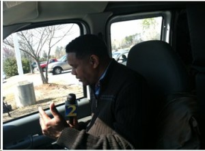 Tom Jones of WSB-TV is hard at work outside the Clayton County Court House in Jonesboro, GA, on March 27, 2013, preparing to report a late afternoon story. (Photo by: Robin Hamilton/Full Sail University).